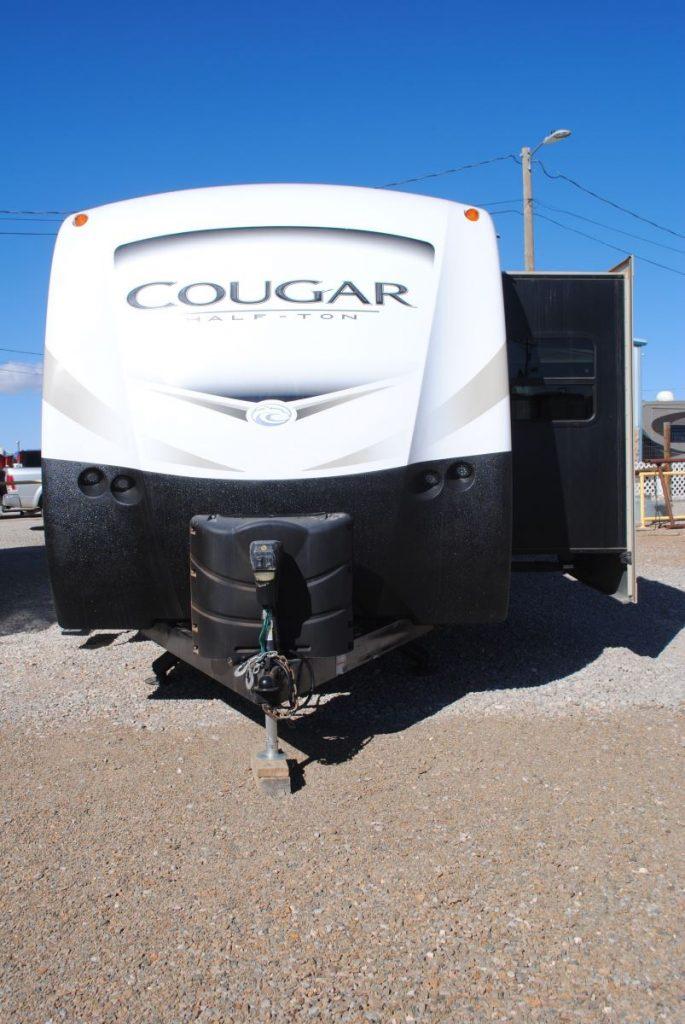 Front view, Cougar Half - Ton logo