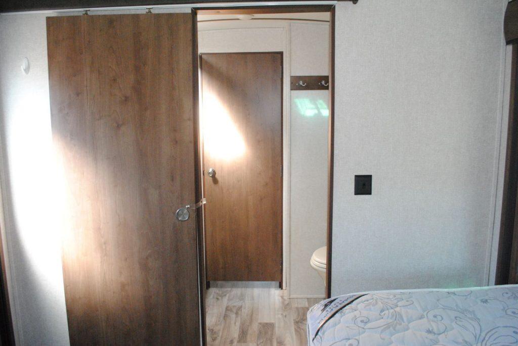 Looking outside the bedroom door, to view another interior door