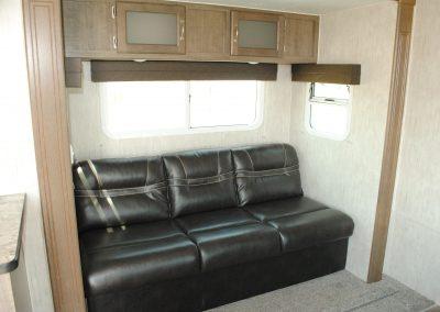 Sofa with overhead storage. Two windows.