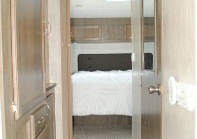 Walk through storage to bedroom.