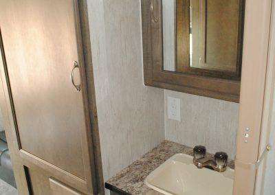 Storage cabinet. Bathroom sink with medicine cabinet with mirror. Under sink storage.
