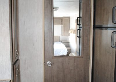 Interior door with mirror. Refrigerator and storage cabinet.
