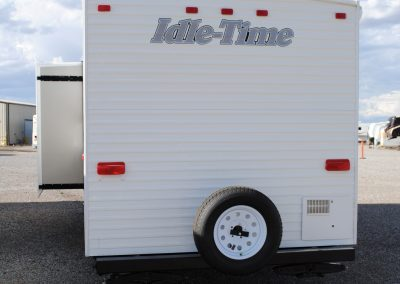 Exterior rear view with side slide extended. Spare tire on bumper.