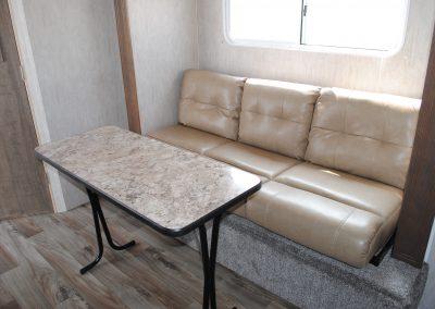 Table and Sofa. Window behind sofa.