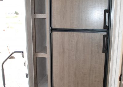 Refrigerator, side pantry and front door.