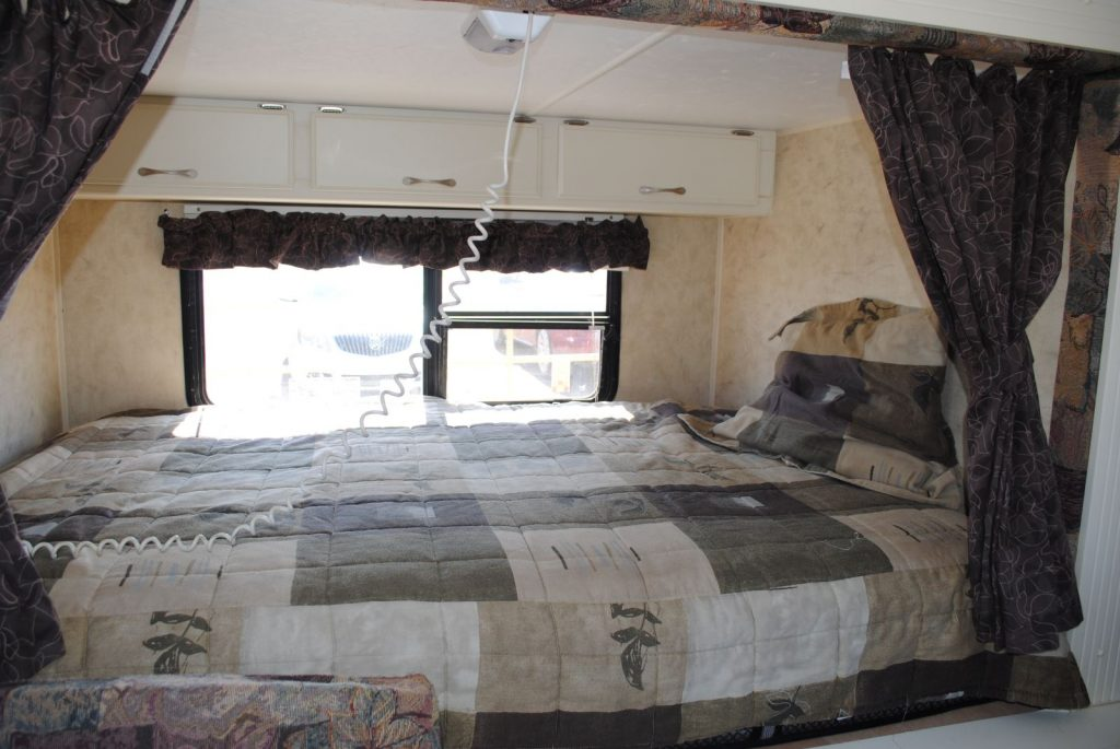 Close up view of bed and window.