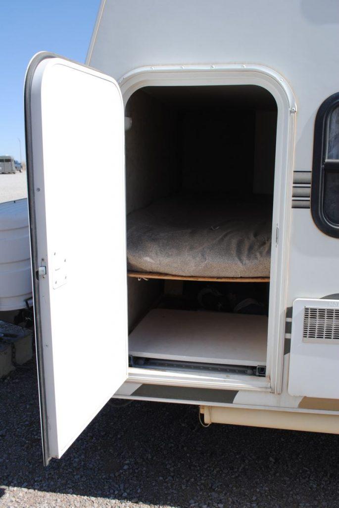 Exterior side door storage.