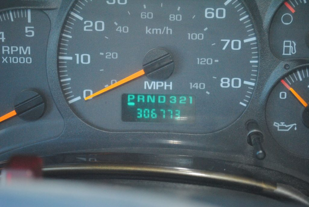 Closeup view of the odometer, counting 306773 miles